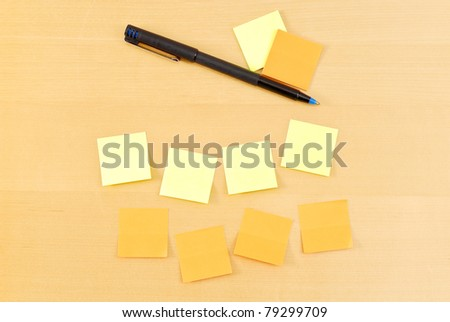 Blank Notes on Table with Pen - stock photo