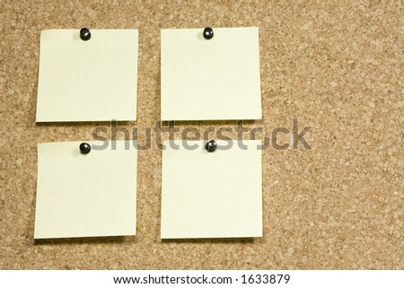 Blank notes pinned on a cork board