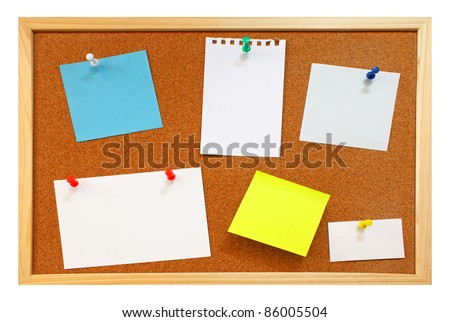 Blank notes with colorful push pins on framed cork board isolated - stock photo