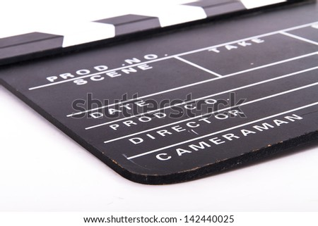 Blank old black film clapper board, isolated on white background. - stock photo