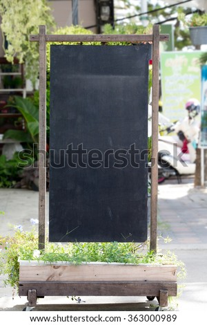 Blank old blackboard stand for add you text - stock photo