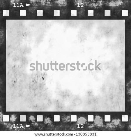 blank old grunge film strip frame background - stock photo