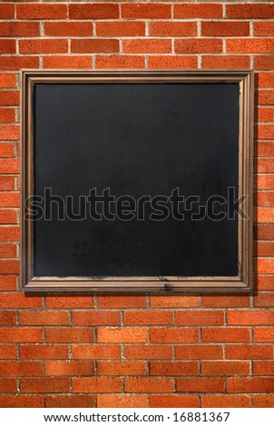 Blank old menu blackboard on a brick wall ready for text.