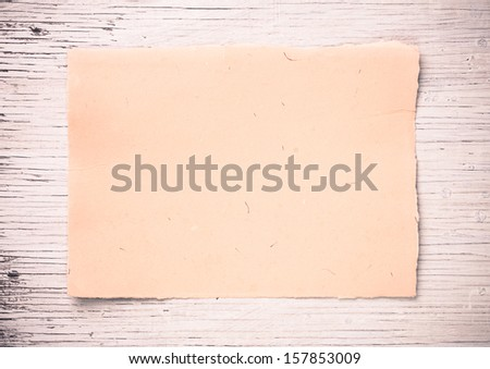 Blank old  paper  on white wooden background - stock photo