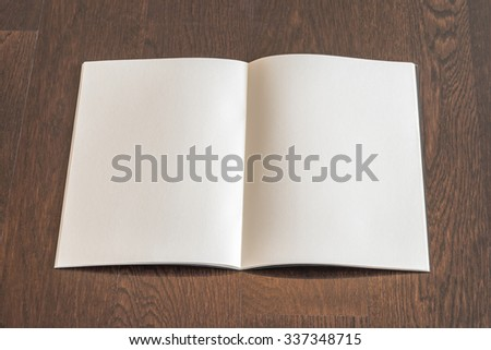 Blank open book, catalog, magazines, brochure, note template with paper texture on dark color wood table/ wooden floor background: Empty textured note book pages on timber backdrop for adding text - stock photo