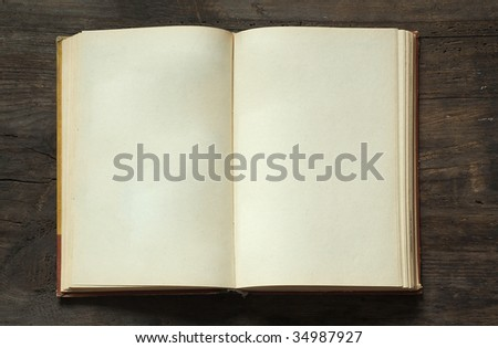 blank open book on old wooden background - stock photo