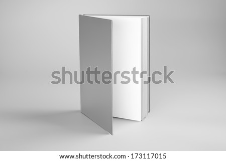 Blank open book standing over gray background - stock photo