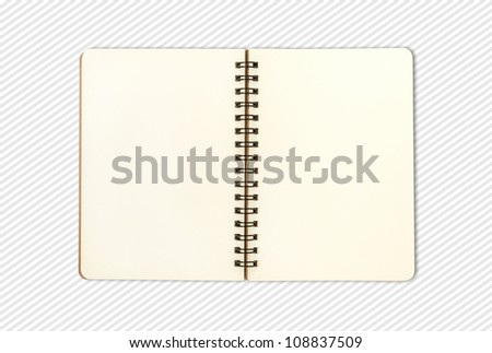 blank open note book on pattern background; contain clipping path - stock photo