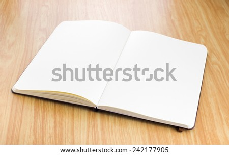 Blank open notebook on wood table,business template.