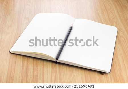 blank open notebook with black pencil on wood table,Business template mock up for adding your text - stock photo
