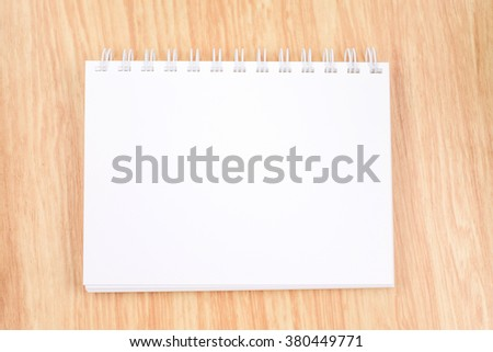 blank open ring binder notebook on wood table,Business template mock up for adding your text - stock photo