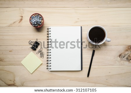 blank opened notebook with cup of coffee and memo note on wooden table. Top view. Writing concept - stock photo