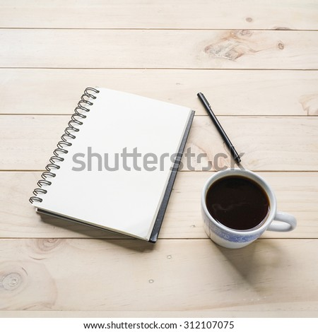 blank opened notebook with cup of coffee and  on wooden table. Top view. Writing concept