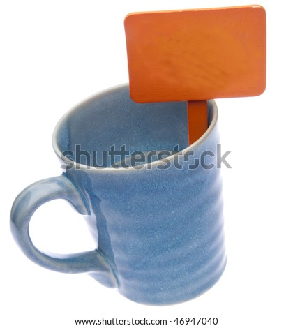 Blank orange garden sign in a blue mug isolated on white with clipping path.