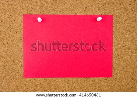 Blank orange paper note pinned on cork board with white thumbtacks, copy space available - stock photo