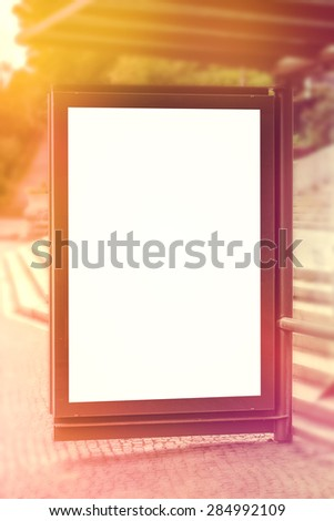 Blank Outdoor Advertising Billboard Hoarding On Bus and Tram Stop Sattion, White Copy Space for Mock Up Design or Marketing Message - stock photo