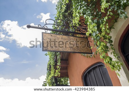 Blank outdoor wood sign of restaurant - stock photo