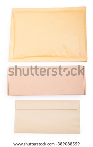 Blank package, box and envelope with copyspace on organized workplace as delivering and correspondence concept