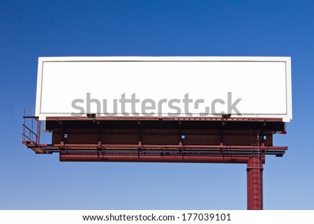 Blank panoramic billboard advertising sign on blue sky background with space for your message - stock photo