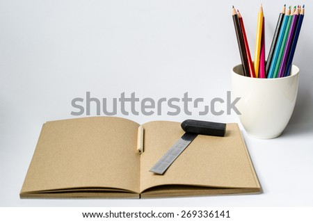 Blank paper and colorful pencils on the White background ,business,education,Learn concept - stock photo
