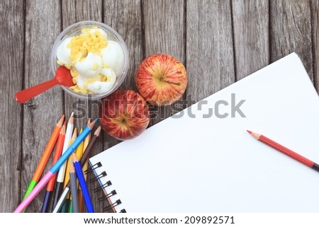 Blank paper and colorful pencils on the wooden table - stock photo