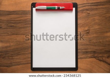 Blank paper and pen on wooden background   - stock photo