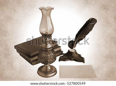 Blank paper card, oil lamp and inkwell with a quill pen as a concept of writing letters and greetings on holidays. Photo in sepia tone.