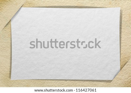 Blank paper cards inserted into another piece of paper background - stock photo