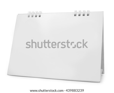 blank paper desk calendar with soft shadows, isolated on white - stock photo