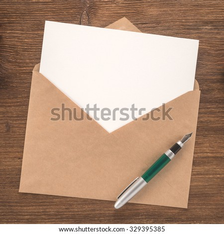 Blank paper, envelope and pen on wooden background    - stock photo
