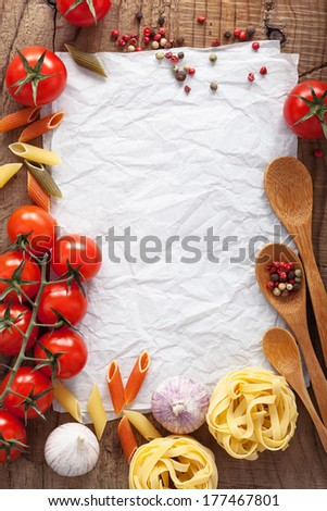 blank paper for recipes with ingredients tomatoes pasta pepper  - stock photo