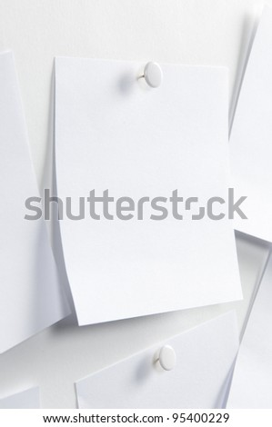 Blank paper, hanging on the wall with a pushpin