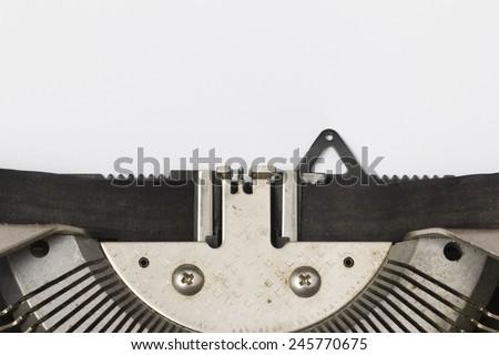 Blank Paper in Typewriter Closeup - stock photo