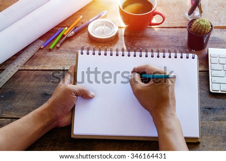 Blank paper note in female hand for any idea on desk work. - stock photo
