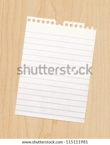 Blank paper note on a wooden background - stock photo