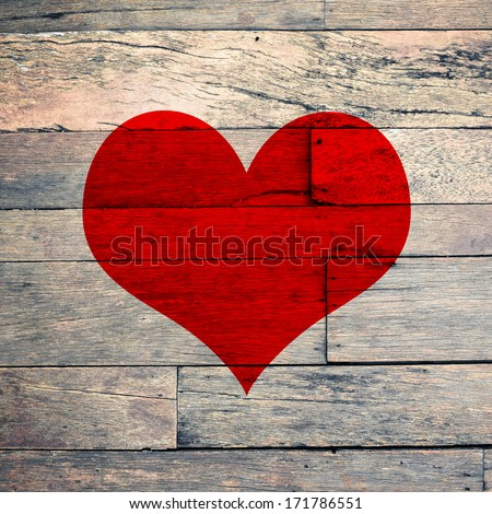 Blank paper note with red heart shape on grunge wooden background with copy space - stock photo