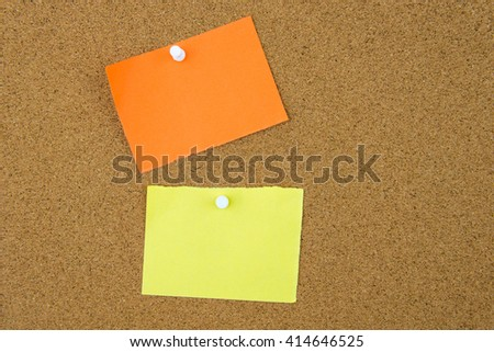 Blank paper notes pinned on cork board with thumbtack, copy space available - stock photo