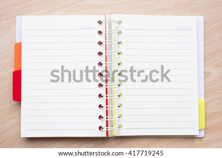 blank paper on desk / Open blank white paper notebook with copyspace wood desk, view from above / for your text or message / top view