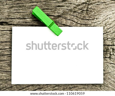 Blank paper on old wood. - stock photo