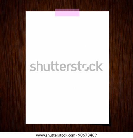 Blank paper on old wood background - stock photo