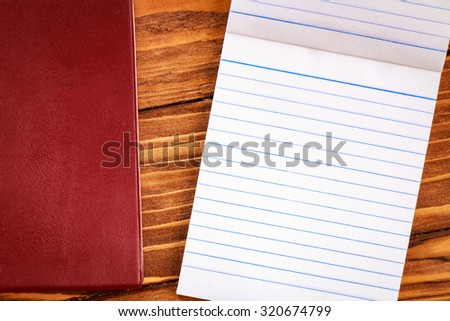 Blank paper on old wooden wall background for put your text.