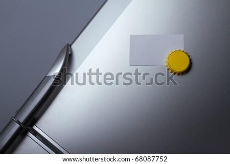 Blank paper on refrigerator door - stock photo