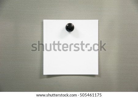 Blank paper on refrigerator door with black magnet