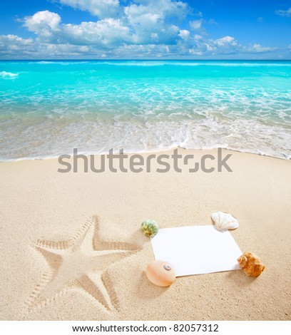 blank paper on summer white sand beach with shells and starfish print [Photo Illustration] - stock photo