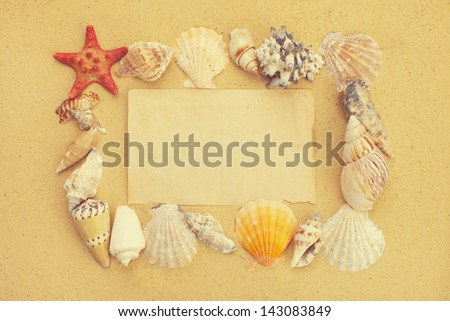 Blank paper on the beach with seashells and starfish
