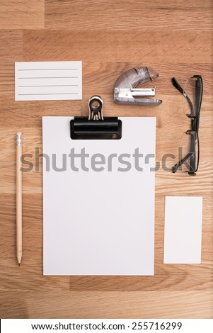 Blank paper on the office table - stock photo