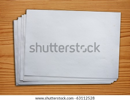 Blank Paper On Wood - stock photo