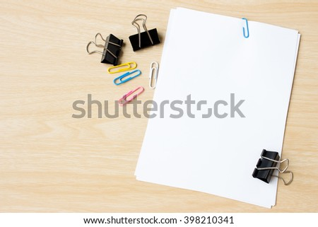 blank paper on wood desk / can you write text message / copy space / top view - stock photo