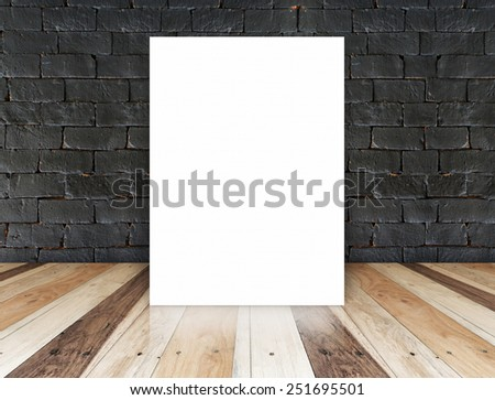 Blank paper poster on the black brick wall and tropical wood floor,template for your content
