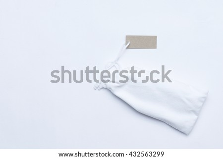 Blank paper price tag or label isolated, Blank tag tied with string. Price tag, gift tag, sale tag, address label   - stock photo